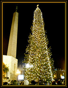 a christmas tree asherah near the obelisk at vatican city